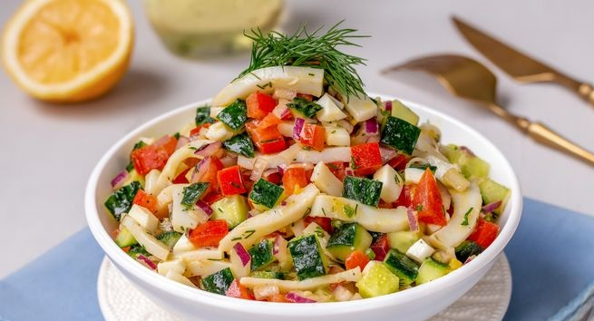 Salad with squid, cucumber, tomato and eggs