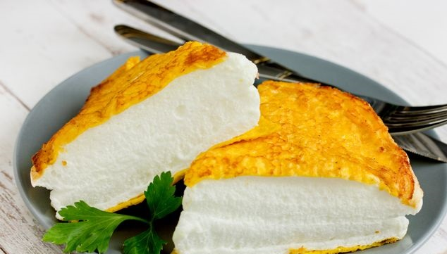 Lush omelet with cream (in a frying pan)