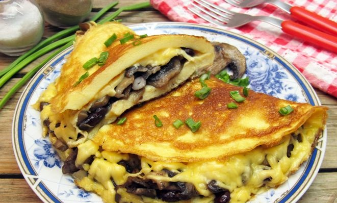 Omelet stuffed with mushrooms, beans and cheese