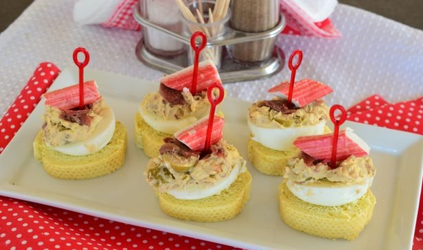 Pinchos with stuffed eggs, crab sticks and anchovies