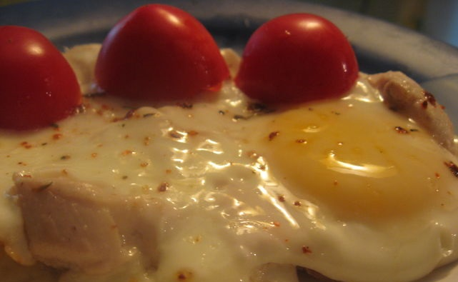 Fried eggs with chicken fillet