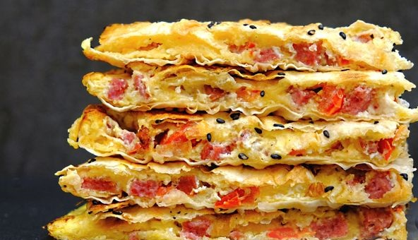 Lavash with cheese, sausage, tomatoes and eggs