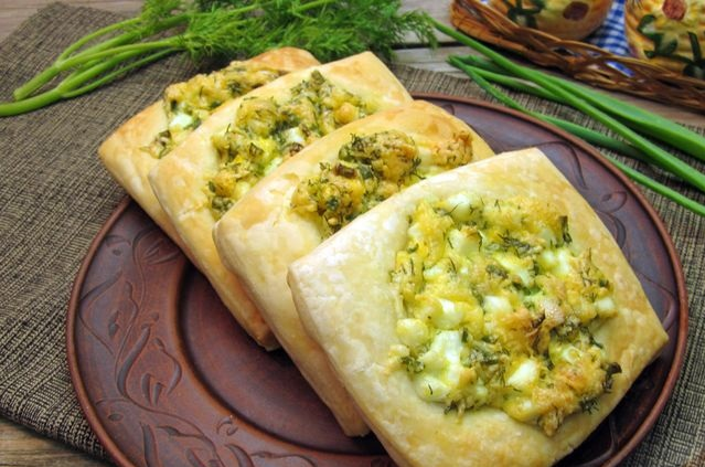Snack puffs with boiled eggs, cheese and herbs