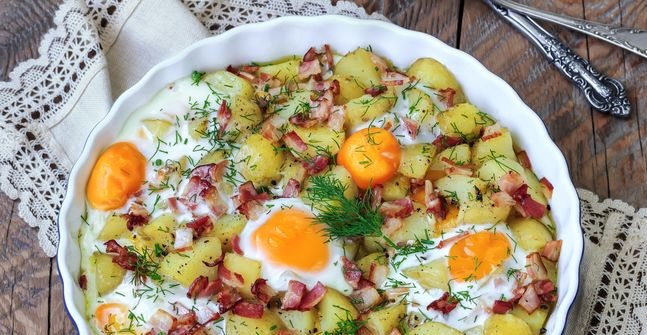 Young potatoes baked with bacon and eggs