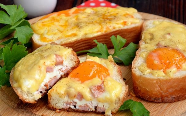 Scrambled eggs in bread, with cheese and sausage