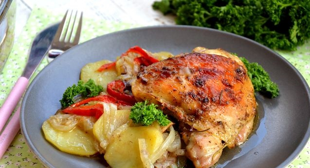 Chicken baked with potatoes, onions, bell peppers and mustard sauce