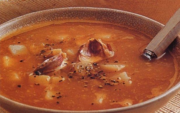 Potato soup with baked garlic