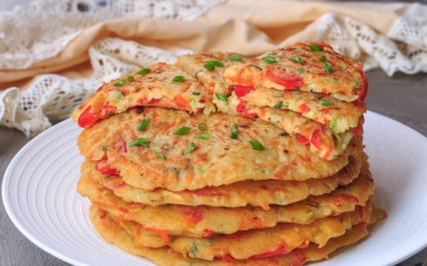 Pancakes with potatoes, peppers, zucchini and carrots