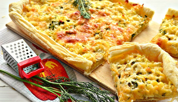 Open pie with potatoes, herbs and cheese