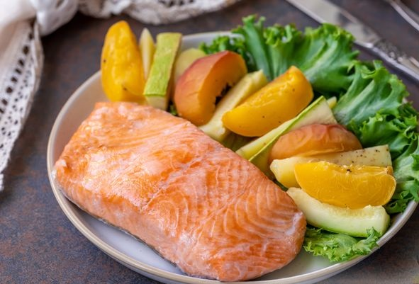 Steamed trout with peaches, potatoes and zucchini