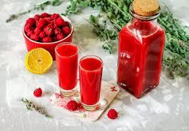 Homemade raspberry liqueur with orange