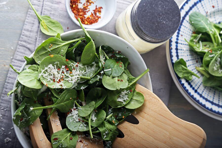 Keto salad with spinach and red hot peppers