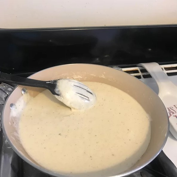 Creamy keto sauce with garlic and cheese