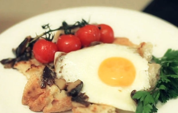 Fried eggs with mushrooms and baked tomatoes