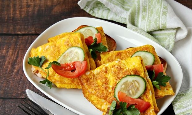 Sandwiches with egg pancakes, ham and cheese