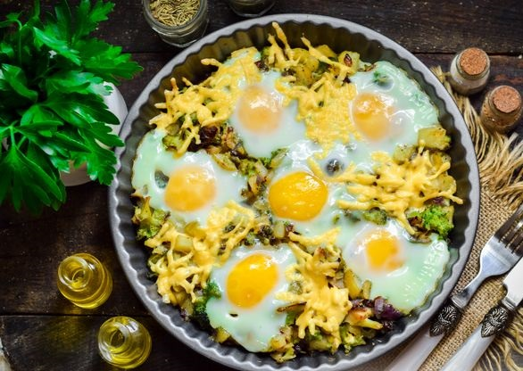 Baked potatoes with broccoli, scrambled eggs and cheese