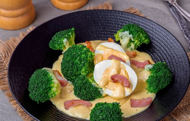 Broccoli with mustard cream sauce, boiled eggs and bacon