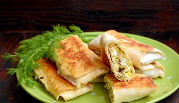 Lavash rolls with smoked cheese and boiled eggs