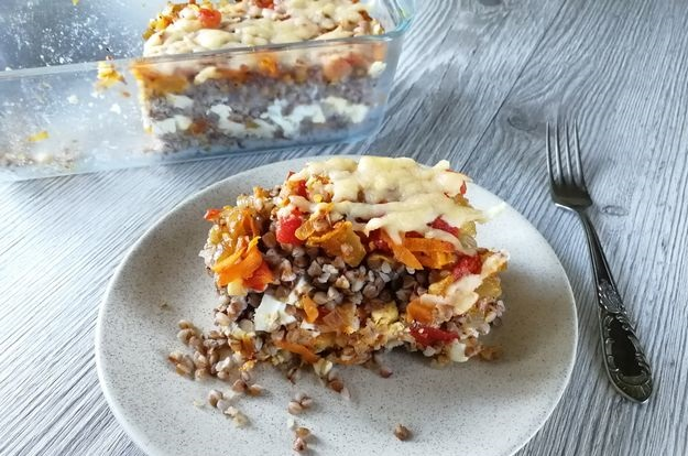 Buckwheat casserole with boiled eggs, vegetables and cheese
