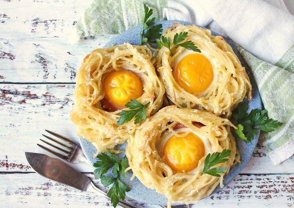 Scrambled eggs in spaghetti and sausage