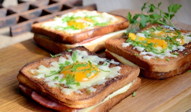 Hot sandwiches with cheese, ham and egg (in a pan)
