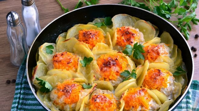 Minced chicken nests with vegetable filling, baked with potatoes