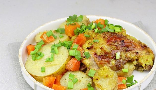 Chicken thighs in mustard and onion marinade, baked with potatoes and carrots