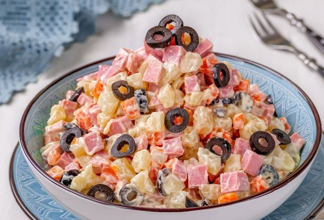 Salad with sausage, potatoes, carrots and olives