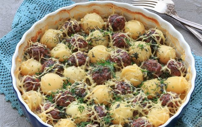 Young potatoes baked with meatballs