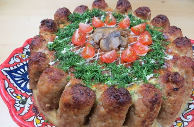 Snack cake made from cutlets, mashed potatoes and mushrooms