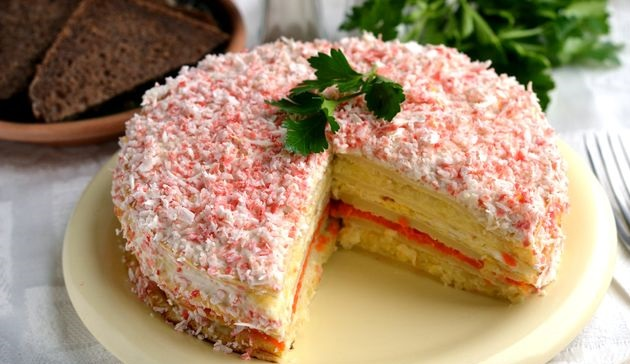 Snack pancake cake with crab sticks, potatoes and carrots