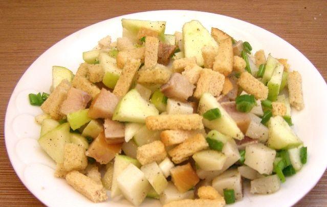 Potato salad with smoked herring and croutons