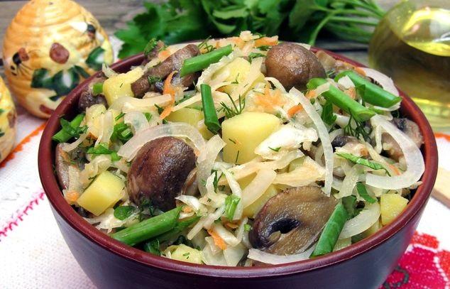 Salad with champignons, potatoes and sauerkraut