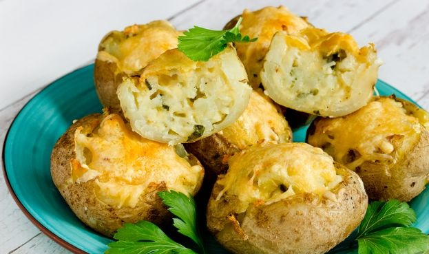 Stuffed potatoes with cheese, in the oven