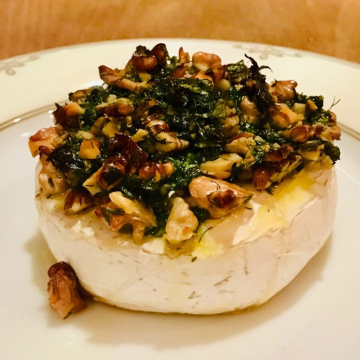 Baked cheese with nuts and herbs. Express recipe