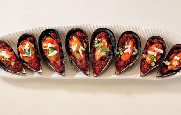 Mussels in half shells with tomato sauce