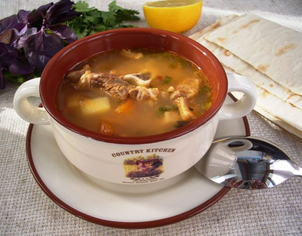 Meat soup with dried apricots