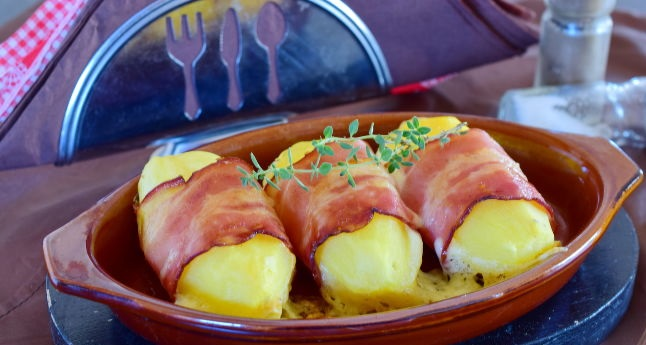 Baked potato with cheese wrapped in bacon