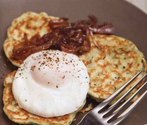 Zucchini pancakes with poached eggs and fried onions