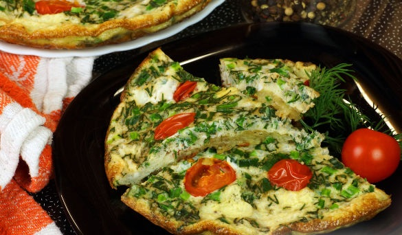 Omelet with potatoes, tomatoes and herbs