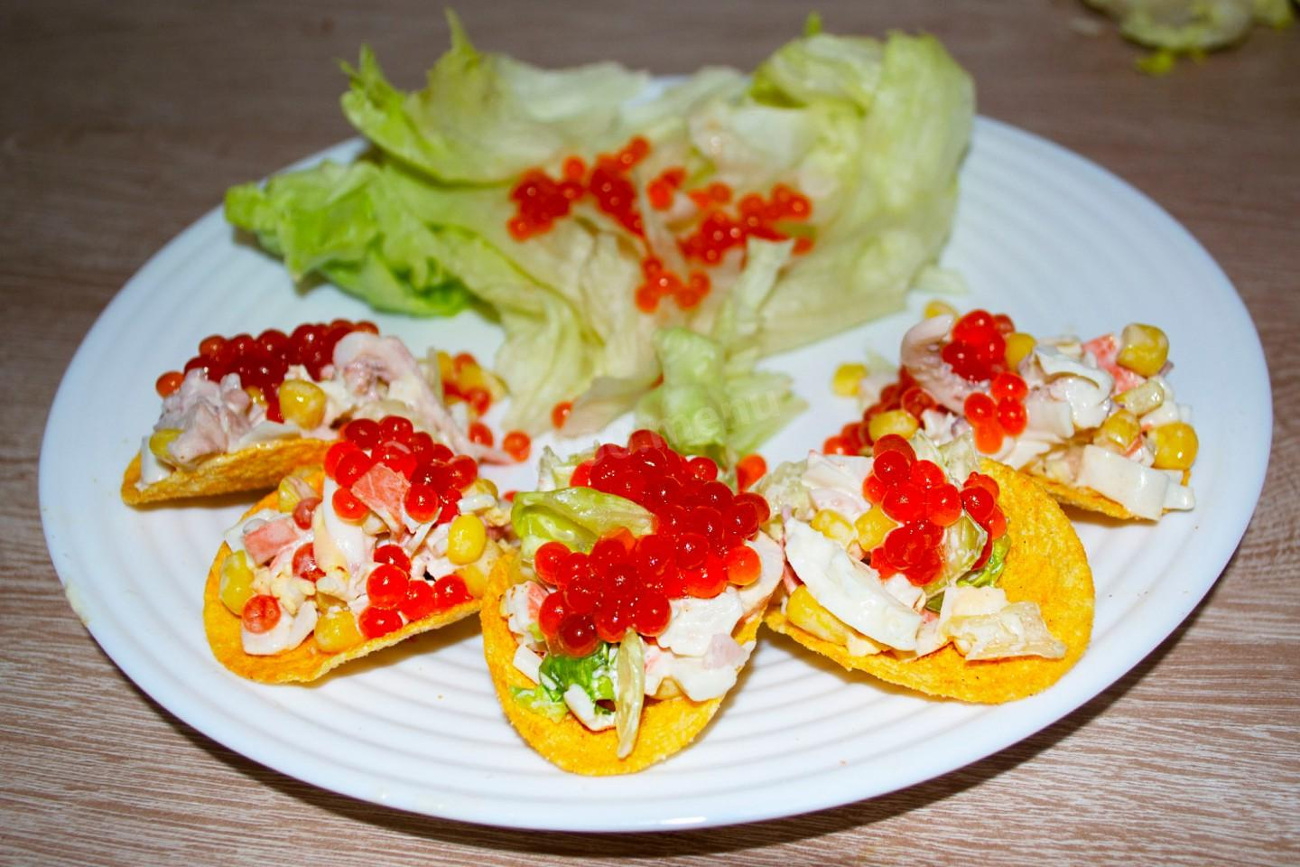 NEW YEAR SNACK FROM CRAB STICKS AND SQUIDS ON CHIPS