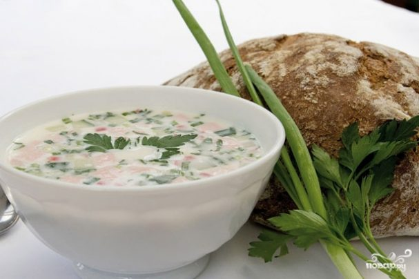 Classic okroshka with sausage on the water