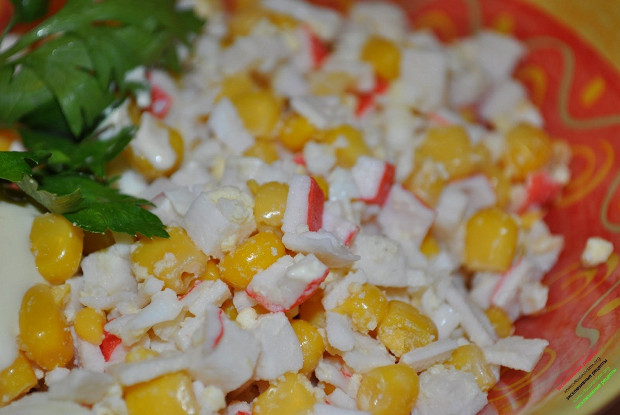 Salad with crab sticks and rice