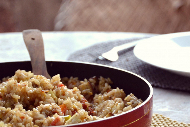 Red biryani rice with paneer and vegetables
