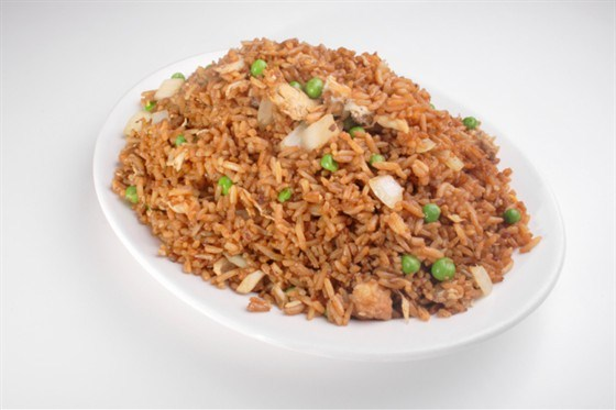 Red rice with spices, chicken and green peas