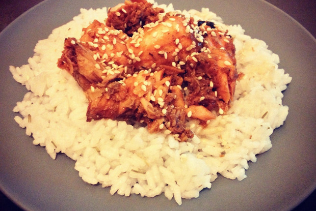 Boiled rice with salmon in sweet and sour sauce