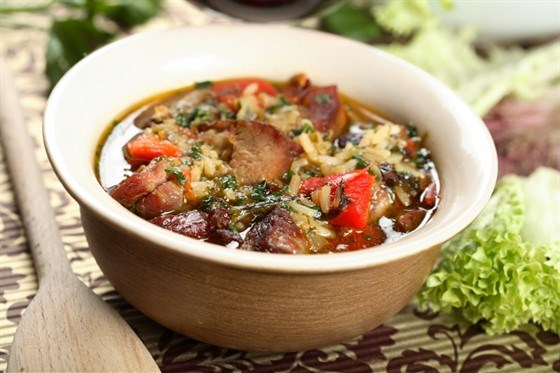 Rice with meat in a pot in Peruvian style
