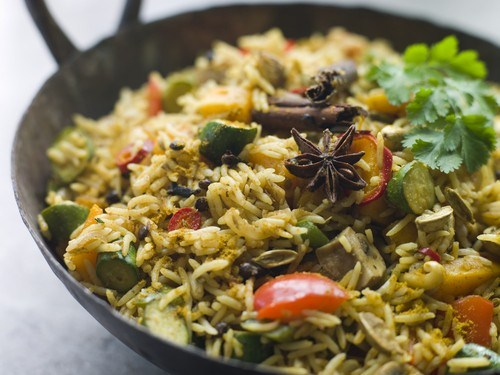 Rice with fried vegetables and mushrooms
