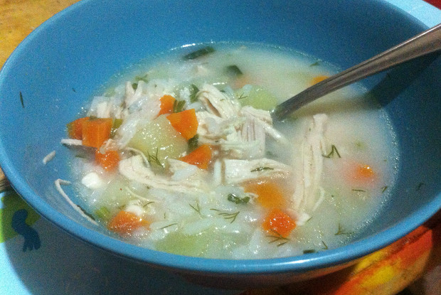 Chicken soup with wild rice and melted cheese