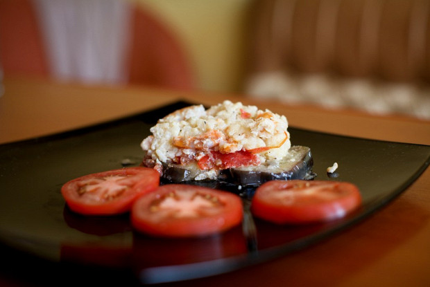 Baked eggplant with shrimps and rice